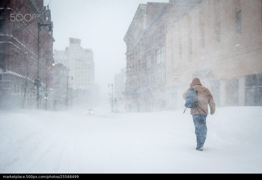 "A man making his way down Congress Street during the blizzard known as ""Nemo."""